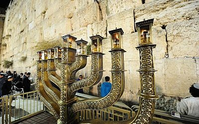 View of Hanukkah menorah on the last night of the eight-day Jewish festival at the Western Wall in Jerusalem Old City, December 19, 2017. (Mendy Hechtman/Flash90)
