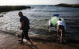 An illustrative photo of people fishing legally at Achziv Beach in northern Israel, on July 3, 2018. (David Cohen/Flash90)