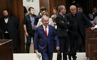 Prime Minister Benjamin Netanyahu arrives at a vote on the ultra-Orthodox draft bill at the assembly hall of the Knesset in Jerusalem on July 3, 2018. (Noam Revkin Fenton/Flash90)