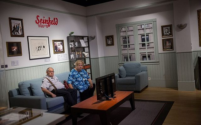 """Visitors at the """"Let There Be Laughter – Jewish Humor Around the World"""" exhibit at the Museum of the Jewish People at Beit Hatfutsot on August 13, 2018. (Miriam Alster/Flash90)"""