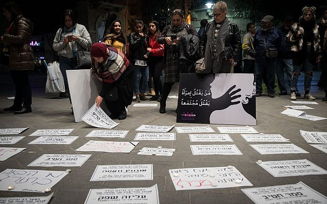 Death notices with names of women killed are put on the ground in Jerusalem's Zion Square as people protest violence against women on November 27, 2018. (Hadas Parush/Flash90)