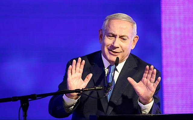 Prime Minister Benjamin Netanyahu speaks at a Likud party event in Ramat Gan marking the first night of the Jewish holiday of Hanukkah, on December 2, 2018. (Miriam Alster/Flash90)