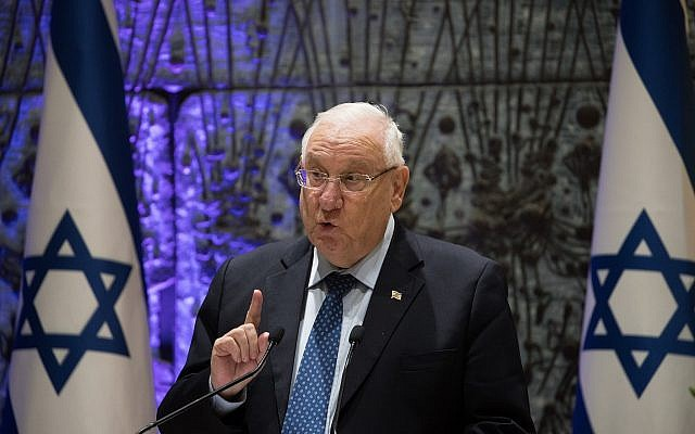 President Reuven Rivlin speaks during a ceremony awarding people who donate to the fight against human trafficking at the President's Residence in Jerusalem on December 2, 2018. (Yonatan Sindel/Flash90)
