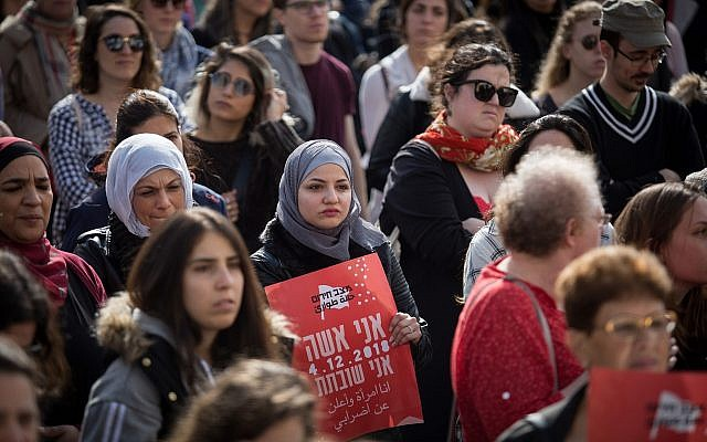 Women shout slogans and holding signs at Safra Square in Jerusalem as they protest against violence against women, December 4, 2018 (Hadas Parush/Flash90)