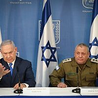 Prime Minister Benjamin Netanyahu (left) and IDF Chief of Staff Gadi Eisenkot deliver statements to the press at the Kirya military headquarters in Tel Aviv, on December 4, 2018 (Noam Revkin Fenton/Flash90)