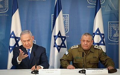 Prime Minister Benjamin Netanyahu (left) and IDF Chief of Staff Gadi Eisenkot deliver statements to the press at the Kirya military headquarters in Tel Aviv, on December 4, 2018 (Noam Revkin Fenton/Flash90)