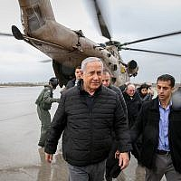 Israel Prime Minister Benjamin Netanyahu walks out of a helicopter as he arrives in northern Israel, December 6, 2018 (Amit Shabi/Yedioth Ahronoth/POOL)
