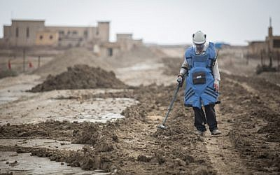A man searches for mines near the site of Qasr al Yahud, the place where Jesus is believed to have been baptized, near the West Bank town of Jericho, on December 9, 2018. (Hadas Parush/Flash90)