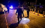 Israeli soldiers and police inspect the scene of a terror attack at the entrance to the Israeli settlement of Ofra in the West Bank, on December 9, 2018. (Ofer Meir/Flash90)