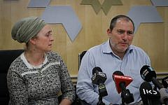 The parents of the pregnant Israeli woman critically injured in a terror attack in the West Bank speak to reporters at Shaarei Tzedek hospital on December 10, 2018. (Yonatan Sindel/FLASH90)