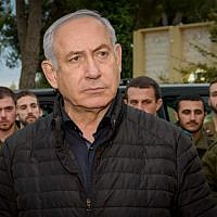 Prime Minister Benjamin Netanyahu speaks with Israeli soldiers during his visit at the Northern Command base in Tzfat, December 11, 2018. (Basel Awidat/Flash90)