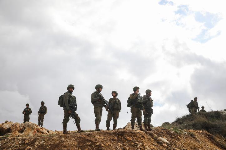 Illustrative  Israeli soldiers guard the scene of a terrorist shooting  attack near Givat Assaf 3f81bdc77ffbd