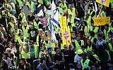 'Yellow vest' protests reach Israel with hundreds marching against the rising cost of living in central Tel Aviv on December 14, 2018. (Miriam Alster/Flash90)