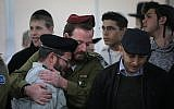 Friends and family members mourn during the funeral of IDF soldier Yosef Cohen, killed in a West Bank shooting terror attack, at the Shamgar funeral home in Jerusalem on December 14, 2018. (Yonatan Sindel/Flash90)