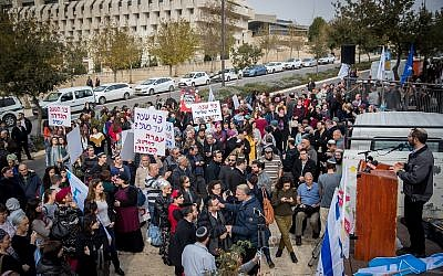 Settlers and right-wing activists protest against the ongoing terror attacks against Israelis in the West Bank outside the Prime Minister's Office in Jerusalem, on December 16, 2018. (Yonatan Sindel/Flash90)