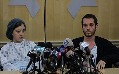 Shira (left) and Amichai Ish-Ran, both injured on December 9, 2018 when a Palestinian terrorist opened fire on Israelis near the settlement of Ofra, hold a press conference at the Shaare Zedek hospital in Jerusalem on December 16, 2018. (Yonatan Sindel/FLASH90)