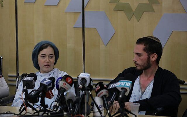 Shira and Amichai Ish-Ran, both injured last week when a Palestinian terrorist opened fire on Israelis near the settlement of Ofra, hold a press conference at the Shaare Zedek hospital in Jerusalem on December 16, 2018. (Yonatan Sindel/FLASH90)