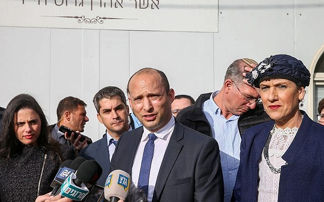 Education Minister and leader of the Jewish Home party Naftali Bennett speaks with the media as he arrives for a special faction meeting in the Israeli outpost of Givat Assaf, in the West Bank on December 17, 2018. (Yonatan Sindel/Flash90)