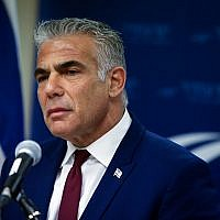 Yesh Atid leader MK Yair Lapid speaks to the media in the Knesset, on December 24, 2018. (Yonatan Sindel/Flash90)
