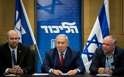 Prime Minister Benjamin Netanyahu, center, at a Likud faction meeting on December 24, 2018. (Yonatan Sindel/Flash90)