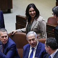 From left to right: Energy Minister Yuval Steinitz, Public Security Minister Gilad Erdan, Culture Minister Miri Regev (standing), Prime Minister Benjamin Netanyahu, then-transportation minister Israel Katz and Science and Technology Minister Ofir Akunis during a Knesset vote on a bill to dissolve parliament, at the Knesset in Jerusalem on December 26, 2018. (Yonatan Sindel/Flash90)