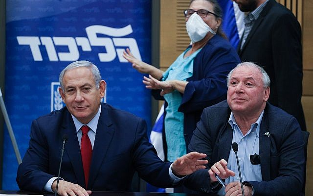 Prime Minister Benjamin Netanyahu leads a Likud faction meeting in the Knesset on December 24, 2018, confirming early elections. At his side is coalition chief David (Dudi) Amsalem (Yonatan Sindel/FLASH90)