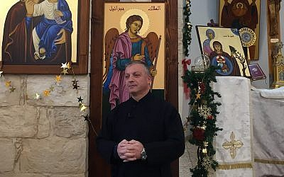 Father Michael Assi, in the Mar Elias church in Fassuta. (Federico Maccioni/ Times of Israel)