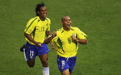 Ronaldo (left) of Brazil celebrates scoring the equalizing goal against Turkey with team mate Ronaldinho during the World Cup Group in Ulsan, South Korea on June 3, 2002. (Clive Brunskill/Getty Images)