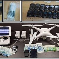 A picture released by the Shin Bet security agency on December 6, 2018, shows cellphones, a drone and cash that were allegedly tied to a failed attempt to smuggle phones into a security prison using a drone. (Shin Bet)