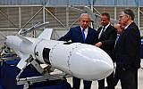 Prime Minister Benjamin Netanyahu, left, during a tour of an IAI facility on December 17, 2018. (Koby Gideon/GPO