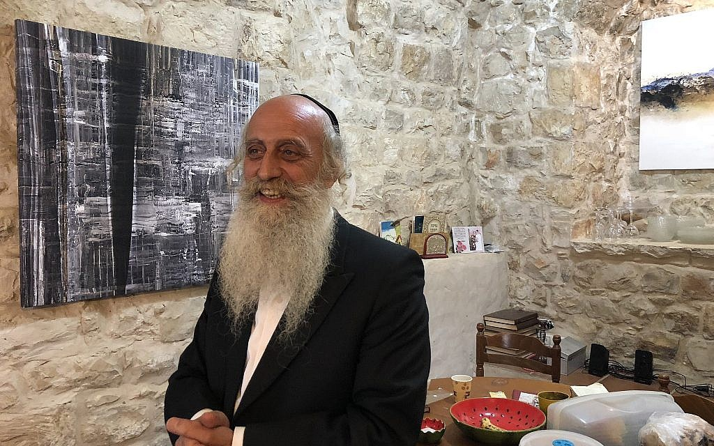 Artist Yoel Tordgman, a French-born artist whose life in Safed infuses his work, like many others who live in the Galilean city (Jessica Steinberg/Times of Israel)