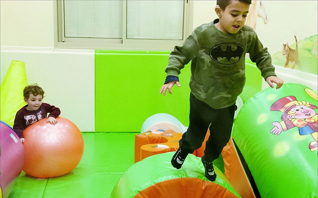 A boy with cancer plays at Daycare of Dreams, a special facility maintained by the nonprofit group Larger Than Life in Ramat Gan. (Larry Luxner/ Times of Israel)