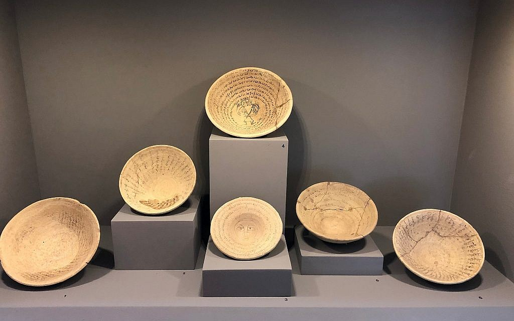 At Jerusalem's Bible Lands Museum ahead of the December 30 Finds Gone Astray exhibit, six incantation bowls, three with a Jewish Aramaic inscription, three in Syrian Aramaic, which originate from southern Mesopotamia and date to the 5th–7th centuries CE. (Amanda Borschel-Dan/Times of Israel)