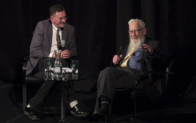 Israeli Nobel Prize winner Prof. Robert Yisrael Aumann (right) speaks with journalist Matthew Kalman at a Times of Israel Presents event at Beit Avi Chai in Jerusalem, December 12, 2018. (Dana Bar Siman Tov)