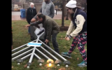 People help lift a menorah that was toppled in Cambridge, Massachusetts on December 3, 2018 (Screencapture/Twitter)