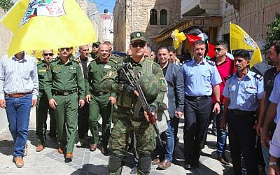 Palestinian Authority security forces touring Israeli-controlled Hebron in uniform. (Wafa)
