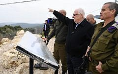 President Reuven Rivlin with IDF commanders near the border with Lebanon on December 16, 2018. (Mark Neiman/GPO)