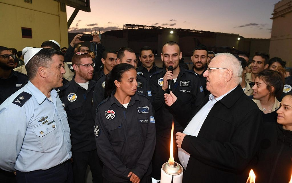 President Reuven Rivlin lights the third candle of Hanukkah with the IAF's 25th Wing at the Ramon Air Force base in southern Israel on December 4, 2018. (Mark Neiman/GPO)