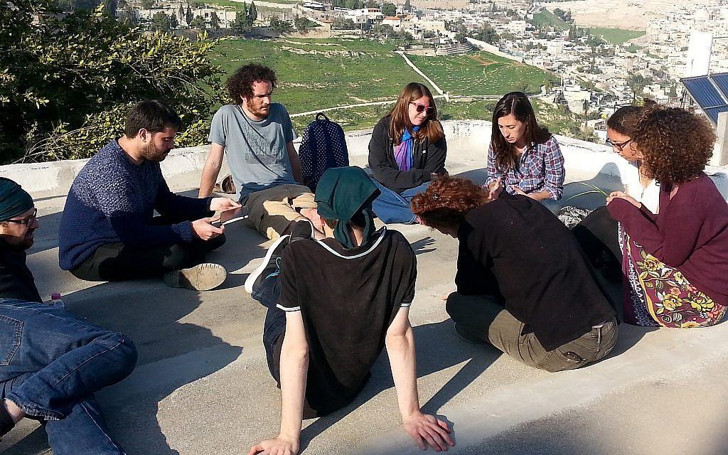 Achvat Amim participants having a rooftop discussion. (Courtesy Achvat Amim)
