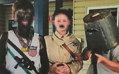 A photo posted by the Rowena Public School in Australia shows students dressed in blackface and an Adolf Hitler costume for a  day at the school to honor historical figures. (Facebook)