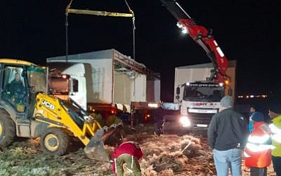 Settlers install a pair of caravans on the hilltop where the illegal Amona outpost once stood on December 13, 2018. (Bezalel Smotrich/Twitter)