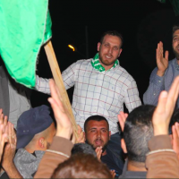 Asem (L) and Salih (R) Barghouti at a rally in Kobar after the former was released from Israeli prison in April 2018 (screenshot: Twitter)