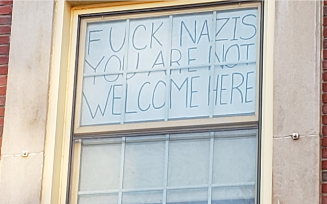 Nicole Parsons, a junior at the University of Massachusetts, Amherst, said she decided to put up this sign after a swastika was drawn over a Happy Hanukkah sign. (Courtesy)