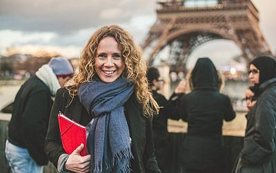 Sharon Heinrich in Paris, across from the Eiffel Tower. (Eyal Yassky-Weiss)