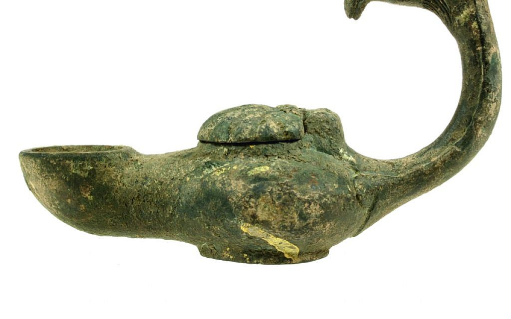 From Jerusalem's Bible Lands Museum's Finds Gone Astray exhibit, an oil lamp with a handle in the shape of a gryphon's head: The lamp probably originates from Iraq or Syria and dates to the 5th–7th centuries CE. (Moshe Amami/Courtesy of Israel staff officer of archeology in the Civil Administration)