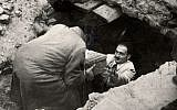 The first 'Oneg Shabbat' archive cache is recovered from the ruins of the Warsaw Ghetto in Warsaw, Poland, September 1946. (public domain)