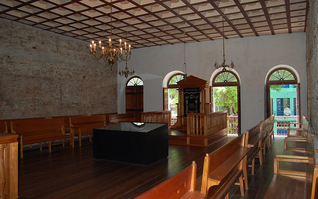 The interior of the Kahal Zur synagogue, once a large Orthodox establishment in Recife, Brazil, that was restored in 2002 as a museum and also contains a small egalitarian shul. (Wikimedia Commons/via JTA)
