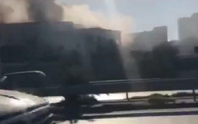 Screen capture from video showing smoke coming from the Foreign Minister building in Tripoli following a suicide bombing, December 25, 2018. (Twitter)