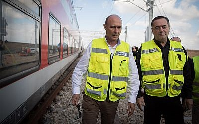 Israel Railways CEO Shahar Ayalon, center, with Israeli Minister of Transportation Israel Katz, right, during a test drive of the Jerusalem-Tel Aviv express train in central Israel, January 16, 2018. (Hadas Parush/Flash90)