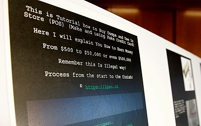 A screenshot of a tutorial posted online by Russian hacker Roman Seleznev on how to steal credit card data is displayed for reporters Friday, April 21, 2017, in Seattle, following the federal court sentencing of Seleznev to 27 years in prison after he was convicted of hacking into U.S. businesses to steal credit card data. (AP Photo/Ted S. Warren)